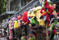 Colorful minions and superman puppets hanging for sale at an old street in Hanoi quarter streets