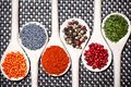 Colorful mix of assortment spices with bean seeds poppy seeds and different types pepper Stock Photo