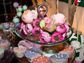 Colorful muffins and arrangement with roses Stock Photos
