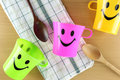 Colorful of Mug with smiley symbols. Royalty Free Stock Photo
