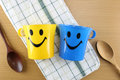 Colorful of Mug with smiley symbols. Royalty Free Stock Photo