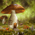 Colorful mushroom houses fantasy meadow with Royalty Free Stock Photos