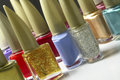 Colorful nail polish bottles closeup Stock Photos