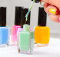 Colorful nail polish bottles manicure Royalty Free Stock Photo