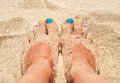 Colorful nails in the sand summertime fun Royalty Free Stock Images