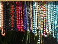 Colorful necklaces of colored crafts on display local market Stock Photography