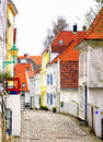 Colorful neighborhood bergen norway buildings of a residential on a cobbled stone street in the port city of on the southwest Stock Images