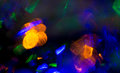 Colorful night lights bokeh over dark background Royalty Free Stock Photo