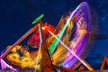 Colorful night ride led lights in motion on a carnival at a state fair Royalty Free Stock Photography