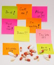 Colorful note papers pile of pills with stressful work instructions and a around it Stock Photo