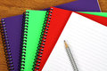 Colorful notebooks ond pencil Stock Photo