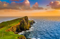 Colorful ocean coast sunset at neist point lighthouse scotland united kingdom Royalty Free Stock Photo