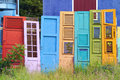 Colorful old doors collection of wooden leaning on fence Royalty Free Stock Photography