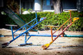 Colorful old and rusty iron seesaw
