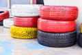 Colorful old used tires on floor Stock Photos