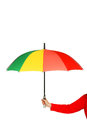 Colorful opened umbrella in hand Royalty Free Stock Image