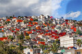 Colorful orange houses suburbs rainstorm mexico city mexico outskirts outside makes pattern Royalty Free Stock Photo