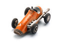 Colorful orange vintage toy racing car Royalty Free Stock Photo