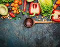 Colorful organic vegetables with wooden spoon ingredients for salad or filling on rustic wooden background top view healthy food Stock Photos