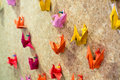 Colorful origami birds with colorful plastic pins Royalty Free Stock Photo
