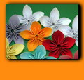 Colorful origami flowers on green background Royalty Free Stock Photos
