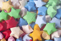 Colorful origami lucky stars background