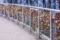 Colorful padlocks on bridge good quality photo of a modern steal over some river in europe full of wedding locks thousands of Stock Image