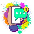 Colorful paint splashes with flat lay modern minimal hand holding mobile phone with new chat message notification. Text new Royalty Free Stock Photo