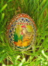 Colorful painted easter egg growing green wheat Stock Photography