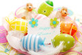 Colorful painted easter eggs greetings card plate feathers Stock Photo
