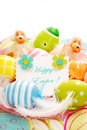 Colorful painted easter eggs greetings card plate feathers Royalty Free Stock Photos
