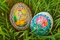 Colorful painted easter eggs growing green wheat Stock Photo
