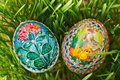 Colorful painted easter eggs between growing green wheat Stock Photos