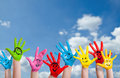 Colorful painted hands with smileys