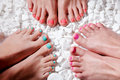 Colorful painted toes pedicured with gel polish amd rhinestones Stock Photos