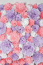 Colorful paper flowers background. Floral backdrop with handmade roses for wedding day or birthday. Royalty Free Stock Photo