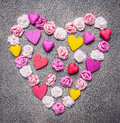 Colorful paper roses laid out in a heart shape on a granite background decorations for Valentine's Day top view close up Royalty Free Stock Photo