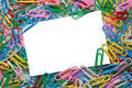 Colorful paperclip background Stock Photos
