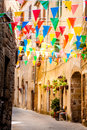 Colorful Party flags wave in a little alley