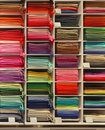 Colorful pashmina scarves shelf inside store Stock Photography
