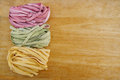 Colorful pasta fettuccine and wood space background Stock Photo