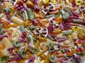 Colorful Pasta, Loop Noodles, Italian Pasta, Farfalle, Fusilli, Penne and others. Background, close-up, format-filling.