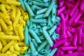 Colorful pasta in yellow, blue and pink Royalty Free Stock Photo