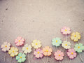 Colorful pastel artificial flower on recycled paper background Royalty Free Stock Photo