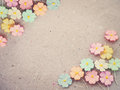 Colorful pastel artificial flower on recycled paper background, Royalty Free Stock Photo