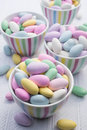 Colorful pastel candies in bowls a buffet of candy dishes Royalty Free Stock Photography