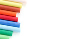 Colorful pastel crayons row of on white background Stock Images
