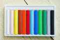 Colorful pastel crayons row of on wooden table Royalty Free Stock Image