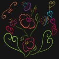 Colorful pattern with graceful flowers and hearts on a black bac