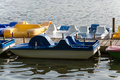 Pedal boats at a wooden pier on a lake Royalty Free Stock Photo